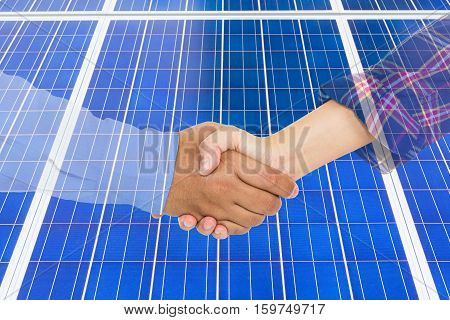 Abstract hand shaking with success in business or partnership on background of solar panels business concept