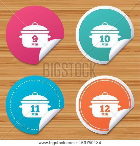 Round stickers or website banners. Cooking pan icons. Boil 9, 10, 11 and 12 minutes signs. Stew food symbol. Circle badges with bended corner. Vector