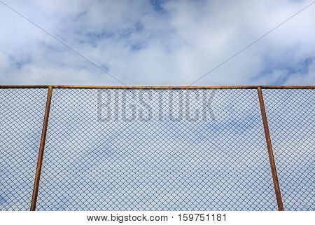 steel fence with cloud and blue sky