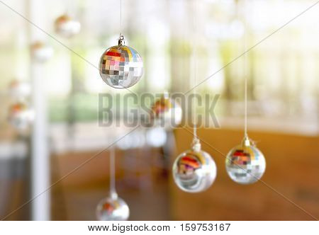 Disco ball or mirror balls on ceiling party decoration copy space.