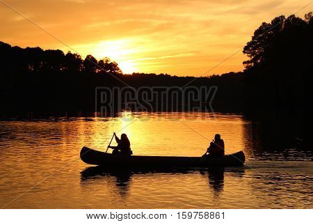A relaxing canoe ride at sunset on a lake