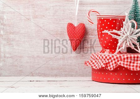 Christmas background with rustic decorations coffee cup gift box and heart shape