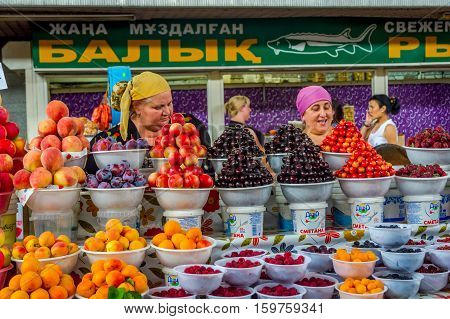 Woman Selling Fruits At Green Bazaar, Almaty