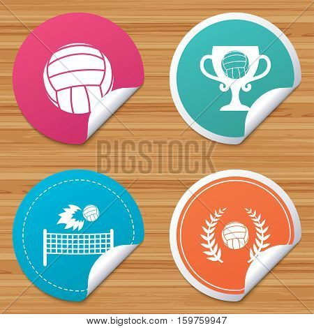Round stickers or website banners. Volleyball and net icons. Winner award cup and laurel wreath symbols. Beach sport symbol. Circle badges with bended corner. Vector