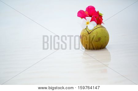 Coconut Drink Decorated With Flowers On Perfect White Sand Tropical Beach