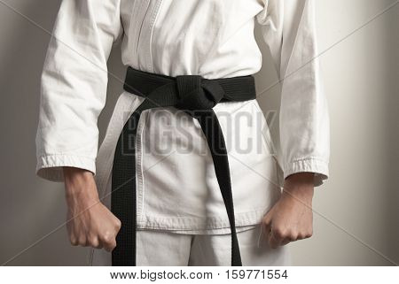 Karate fighter is ready position facing the right side.