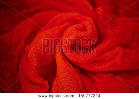 Textured, twisted into a flower gauze. red Close