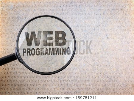 Web Programming. Magnifying optical glass on old paper background.