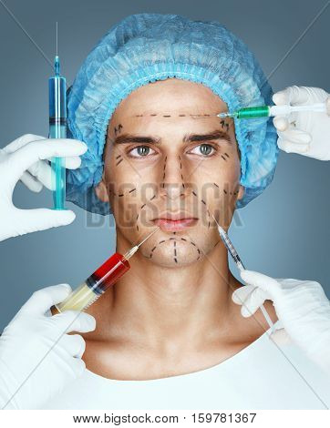 Man in medical hat and beauticians hands with syringes making beauty facial injections. Rejuvenation therapy concept.