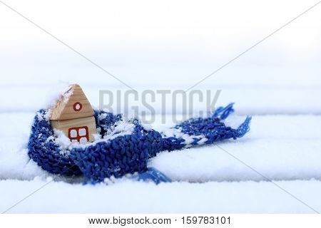 little house in a warming scarf strewn with snow / comfortable accommodation in winter weather