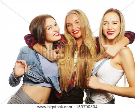 lifestyle and people concept:  Fashion portrait of three stylish sexy  girls best friends, over white background. Happy time for fun.
