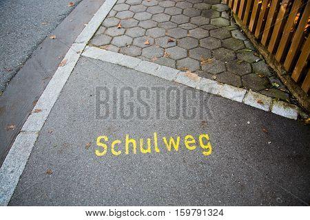 School way written on paving stone, sign