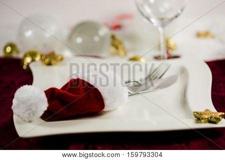 Invitation to eat Christmas dinner Santa Claus hat plates cutlery Christmas balls