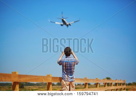 Man Is Looking At The Glide Path And Landing Plane