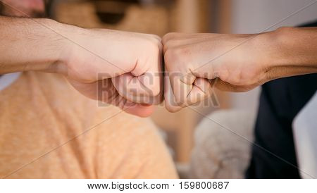 Closeup picture of two best friends men's wrists demonstrating unity and team work between two peoples from different countries.