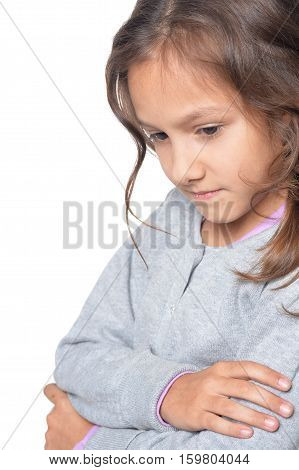 Portrait of pensive little girl isolated on white background