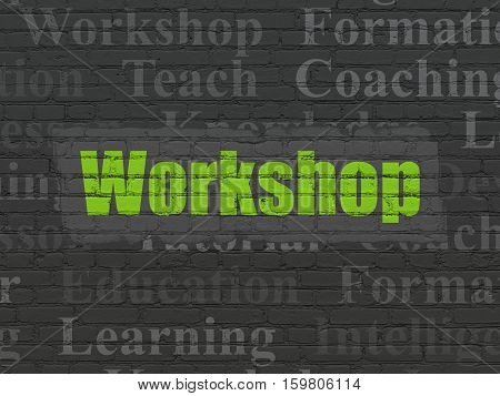 Studying concept: Painted green text Workshop on Black Brick wall background with  Tag Cloud
