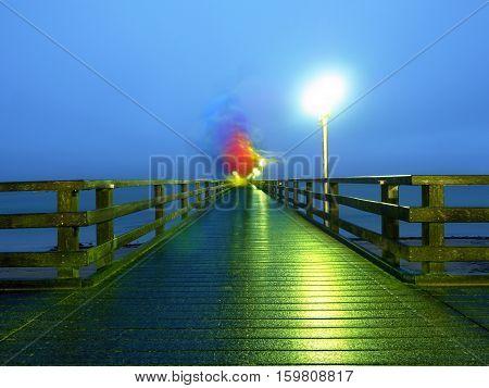 Man Walk In Autumn Mist On Wooden Pier Above Sea. Depression, Dark  Atmosphere.