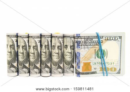 Packs of hundred dollar bills grouped together, isolated with copy space