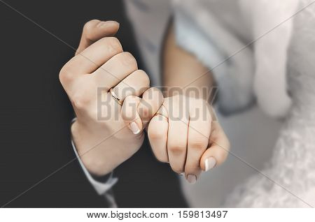 hands of the bride and groom stay in the castle with rings engagement