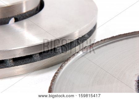 Two brake discs for the car, one new, one old