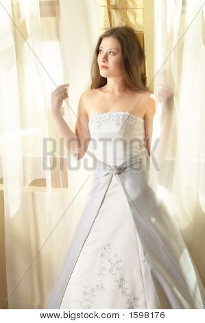 Beautiful Young Bride At Window In Natural Light
