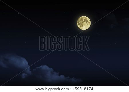 Beautiful magic blue night sky with clouds and fullmoon and stars.
