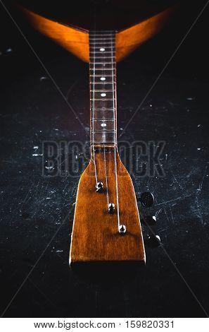 The neck of the Guitar elegant on the black background vintage grunge