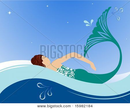 Beautiful mermaid swimming in ocean