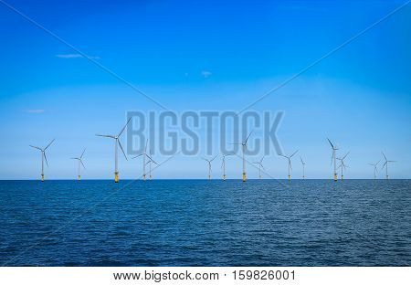 Offshore Wind Turbine in a Wind farm under construction off the Coast of England