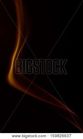 Orange abstract smoke art plume on a black background
