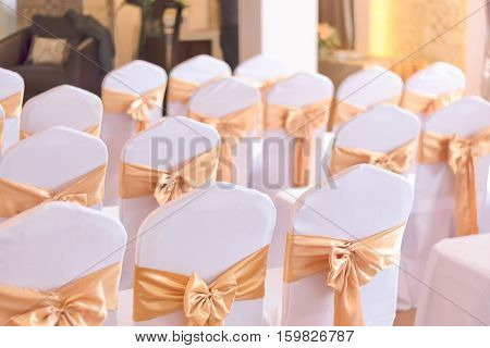 beautiful chairs decoration with ribbon in wedding event hallselective focus.