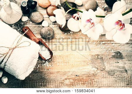Spa setting with herbal massage ball and essential oil. Wellness and spa concept with copy space
