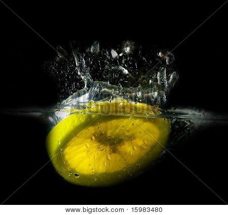 splashing lemon into water