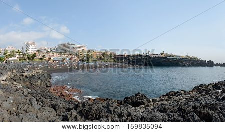 PUERTO DE SANTIAGO, SPAIN - OCTOBER 03: Tourists are visiting on the Arena beach on October 03, 2014 in Puerto de Santiago, Tenerife Island, Canary Islands, Spain.
