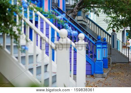 Colorful Porches Of Wooden Houses On Street Of San Francisco, Usa