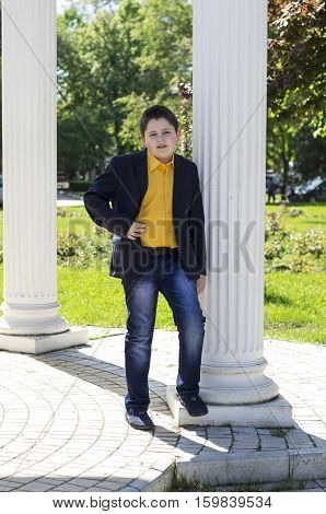 the school student in a jacket and a yellow shirt at colons a subject beautiful children school students