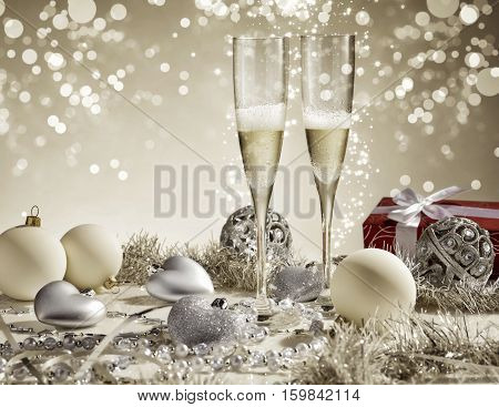 Red gift with white ribbon and two champagne glasses golden decoration