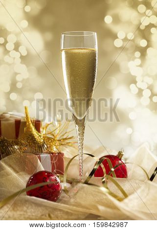glass of champagne with lights in the background. very shallow depth of field.