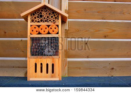 Small wooden insect hotel in the garden