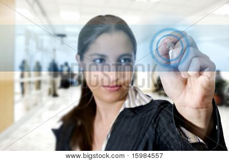 Business woman touch digital interface with a pen (Business and technology concept)