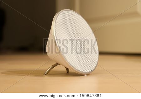 White Portable Speaker with Silver Aluminum Feet