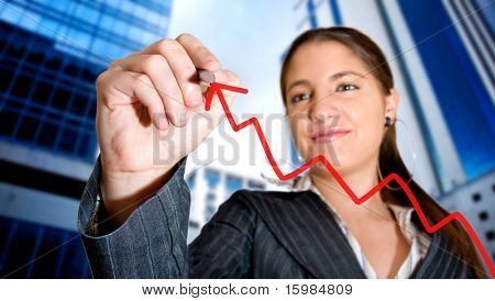 Business woman drawing a graph in the city
