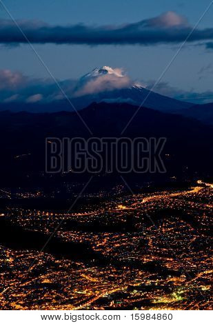 Quito at night with cotopaxi mountain