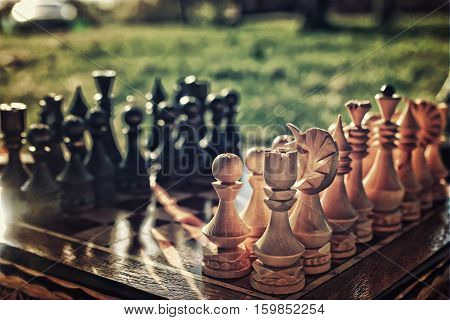 chess pieces arranged on the board mid-game in the fresh air