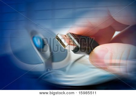 Technology concept: hand holding usb from mouse over technology background