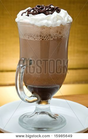 ice latte frappuccino in a big cup with cream and chocolate