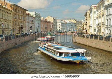 22.06.2016.Russia.Saint-Petersburg.Tourist ships are berthed.They carry city tours.