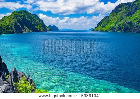Beautiful tropical sea bay. Scenic landscape with mountain islands and blue lagoon El Nido Palawan Philippines Southeast Asia. Exotic scenery. Popular landmark famous destination of Philippines
