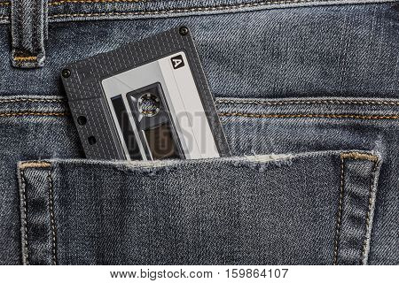 Audio Tape Cassette in the Jeans Pocket.
